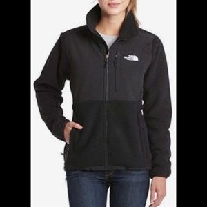 A women's black NorthFace zip up fleece.